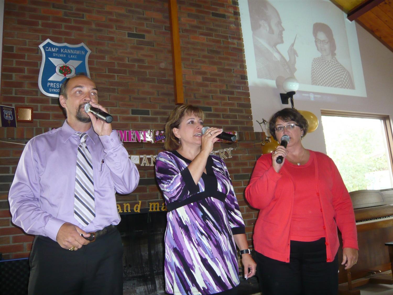 Dale, Dianne and Arlene singing at family anniversary, (Arlene never got the colour memo)